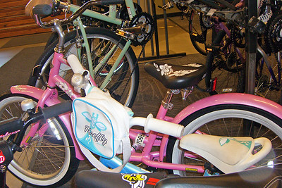 Pink and other bicycles in store