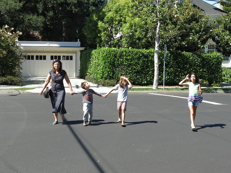 Hadas, Karl, Hazel, and Eden cross Forest Avenue