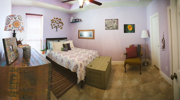 "A panoramic of the guest room.   Merge of 4 photos...the room doesn't really ""sink"" to the middle. :)"