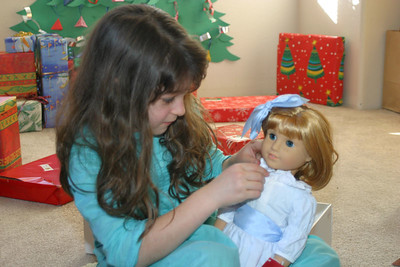 Anisa with an American Girl doll from her Grandad.