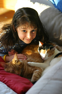 Anisa with the cats in Matthew's house.