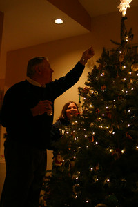 Rich trying to get an ornament on the tree