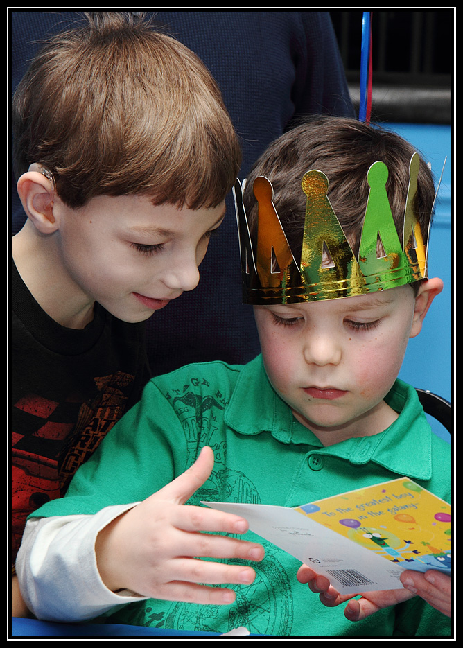 Matthew helps read a card