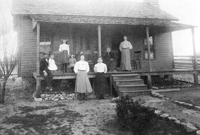 UNKNOWN FAMILY HOMESTEAD Possibly Esther Isabell Curtis Dodson seated