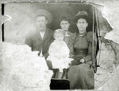 UNKNOWN DUNCAN FAMILY - 1892 I don't know who these folks are, but I like the way this photo is torn for some reason.