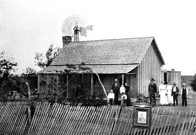 UNKNOWN FAMILY HOMESTEAD With everyone dressed up and a photo hanging on the fence, it's believed this is a photo of a funereal occasion.