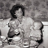 DOROTHY FEEDING ANDY<br /> Linuel Duncan home, Ft Worth, Texas - 1958<br /> <br /> Dorothy with a lapful of Diane and Andy Duncan