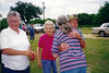 "DUNCAN REUNION<br /> The Thomas L ""Ell"" Duncan home, Star, Texas - 1996<br /> <br /> Shirley Duncan, unidentified woman, Carmel Miles hugging unidentified man"