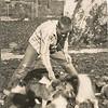 Ronald L. Dungan Princess and her puppies C. 1957