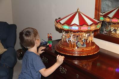 Elliot LOVES the Merry-go-round from Caroline