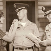 1964-07-31 - Dwaine receives 1st Lieutenant bars. Pinned on by Jo. Orders read by Major Clarence C Igo.