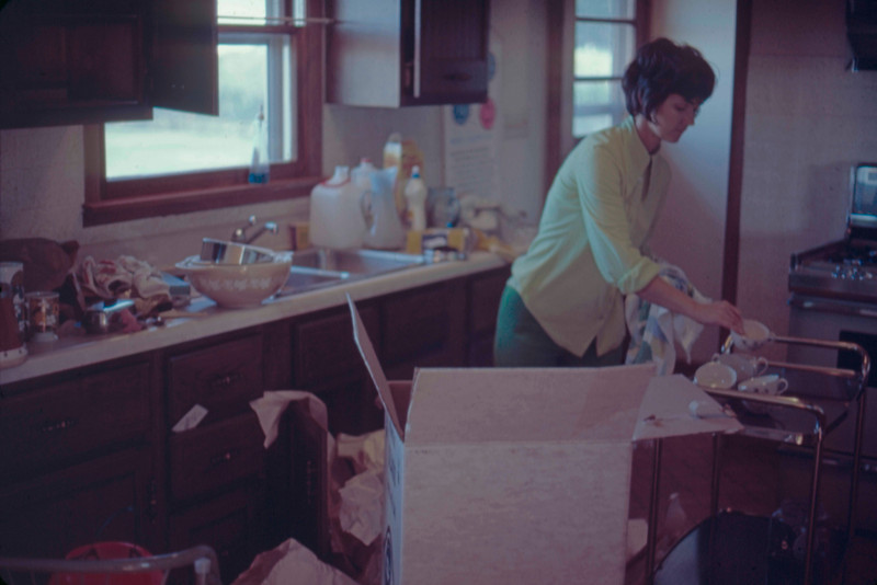 1972-10 - Jo unpacking at house in Dakota City.