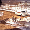 1974-12 - Clearing ice dam at bottom of driveway - Jeff Randy & Jo