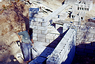 1974-09 - Block mason at work