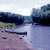 1975-08 - Canoe on bank of St Croix River
