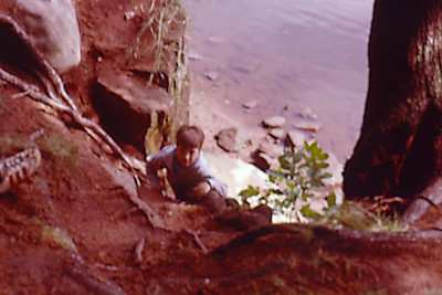 1975-08 - Jeff climbing bank of St Croix River