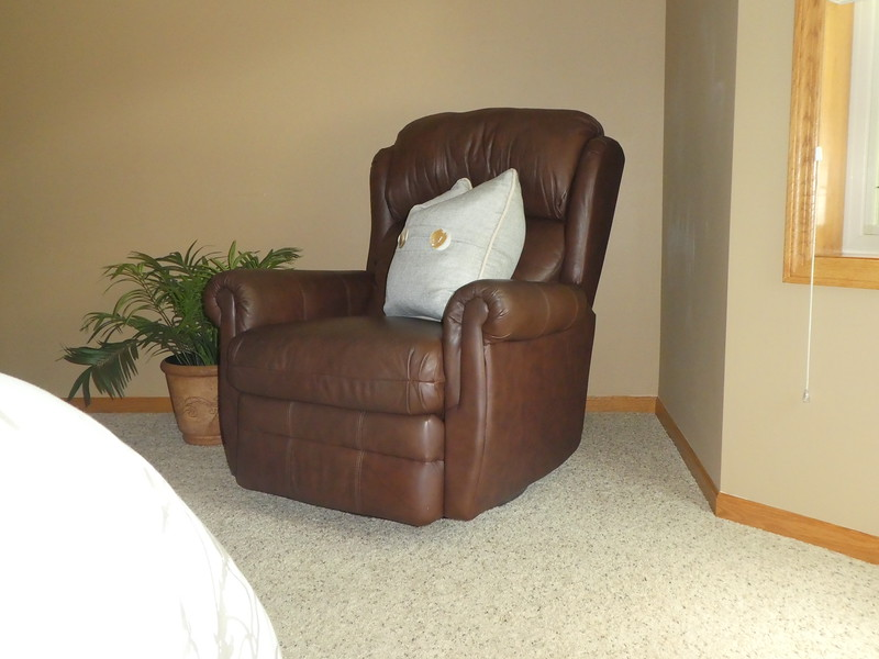 Moved recliner from living area and added pillow and planter. We had sold the dresser.