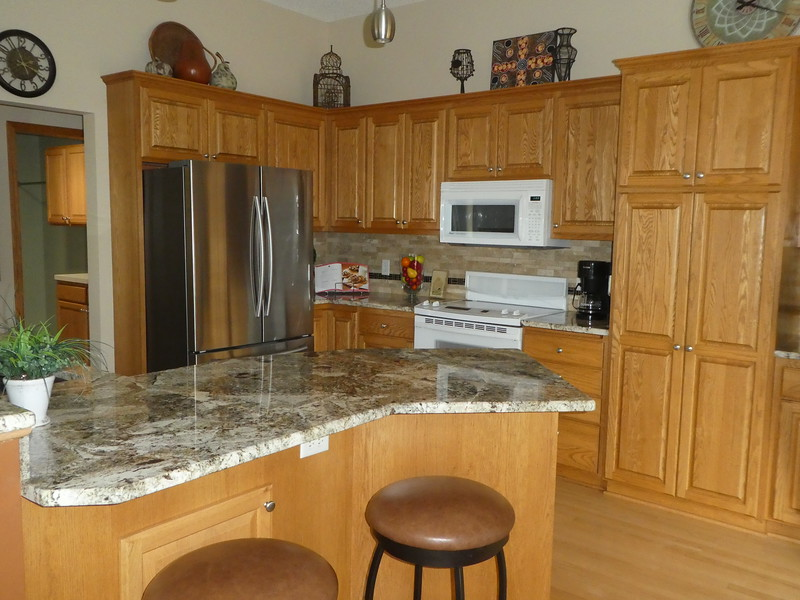 Kitchen. Everything removed from the counter tops except coffee pot. Added accent pieces.