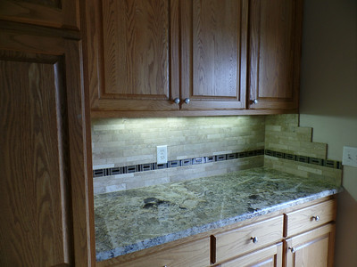 Kitchen - by patio door - grouted