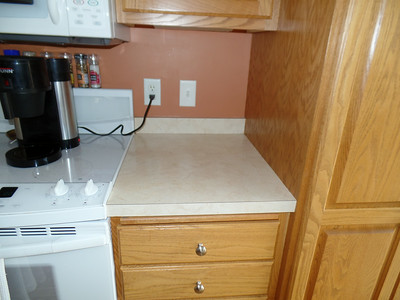 Counter between stove and pantry