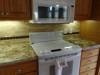 Kitchen - either side of stove - grouted