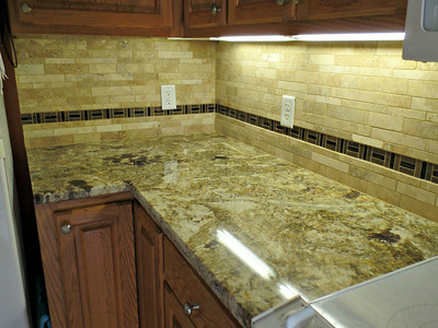 Kitchen - between reefer and stove - grouted