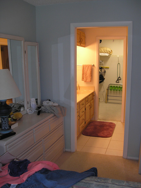 View into dresser and closet for master suite