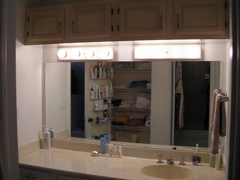 Master bathroom - Dresser and open linen closet taken from bathroom