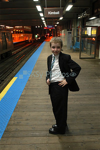 """""""So...who's the cutest 12 year-old in a suit headed toward Kimball on the Brownline in Chicago, April 2007?"""""""