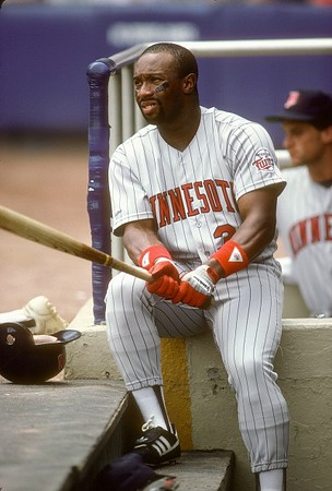 UNSPECIFIED - CIRCA 1989: Outfielder Kirby Puckett #34 of the Minnesota Twins looks on from the dugout during a Major League Baseball game circa 1989. Puckett played for the Twins  from 1984-95. (Photo by Focus on Sport/Getty Images)