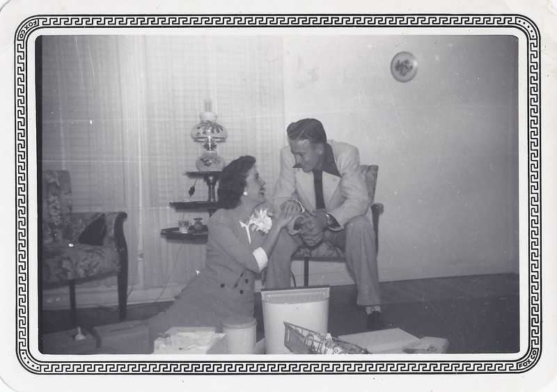 Mom and Dad - opening wedding gifts in February 1950