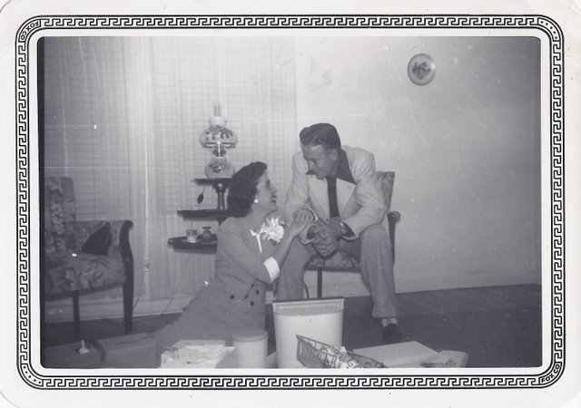 Mom and Dad - opening wedding gifts in Feburary 1950