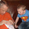 Tarek watching Grandpa open a package of orange Circus Peanuts.  T looks like he's got his mouth all set to share a few bites.