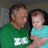 Kennedy and Grandpa at Kennedy's first birthday celebration, April 2010.