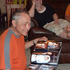 Grandpa looks at the photo book given to him by Melodie.  I think he likes it.