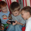 Ben, Hayden, and Conner are mesmerized by an iPhone movie.