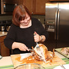 Chef Pam cuts the turkey.