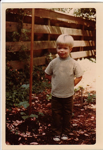 Chris, age 3, with 1st bean plant.  This photo was taken the morning my labor started. Pete wanted to finish the roll of color film, and put black and white film (which he could develop) in the camera to record the birth of the baby.