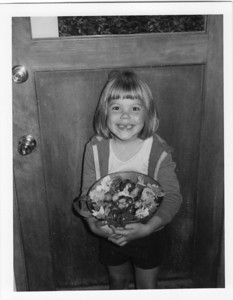 Sept 26, 1978.  Tonya, age 6, holding garden produce: tomatoes, bell peppers, parsley, and very small potatoes, plus nasturtiums and marigolds.