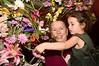 Sophia helps flower the cross at St. John's, on Easter Sunday