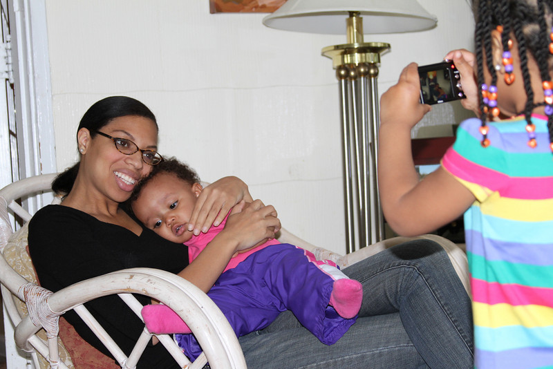 Kirby hold her baby sister and Monroe taking a picture