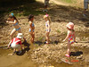 Hillbilly children playing in a few inches of water!