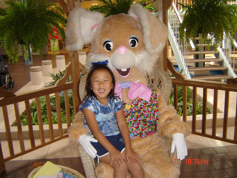 Abby with the Easter Bunny at Hulen Mall.  Dillon was very scared of him(Her,IT?)