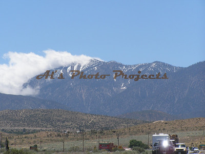 On the road near Pearblossom, between Palmdale & Victorville, June 16, '05,  Temp over 100.  We sure had water in '05!!!  Look at the snow in the mountains.  Off to 'Vegas...