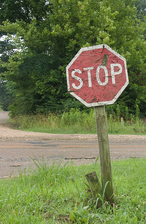 Then you turn right past the old wooden Stop sign. -George Hamma