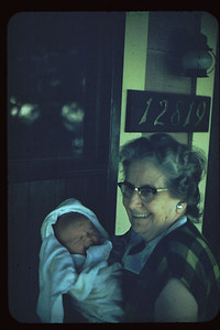 A cheerful Grandma Potwin and baby John at our front door at Rancho.