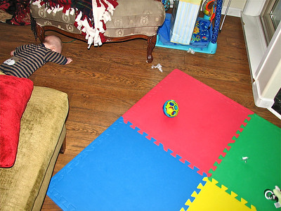 Rolling sideways is not a good solution to crawling backwards (he started in the middle of the mat)