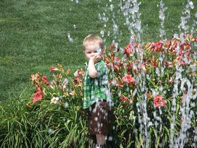 Edmund playing at the water feature at Burien town square