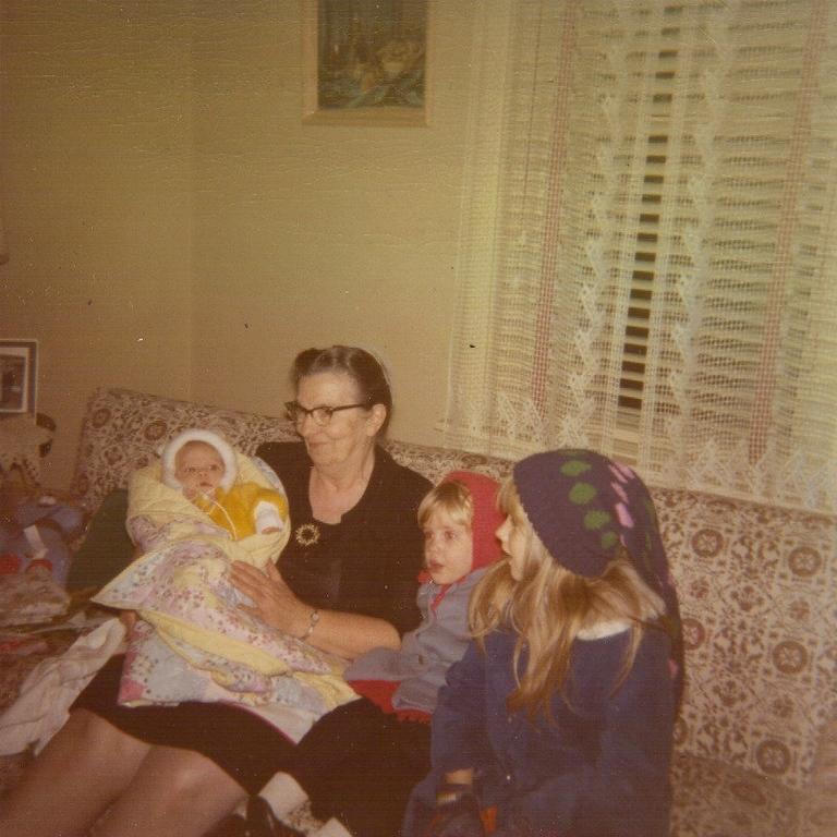 Grammy Hunsberger (Sara) holding newborn Amelia, with Lydia & Anna Lisa