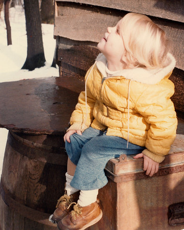 Circa 1983? Sophie, age 4?  --  Sitting by the goat pen